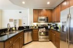 Upgraded kitchen with stainless steel appliances and black granite counters