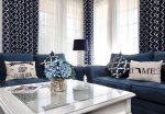 The entire living space is color coordinated in navy blue and white