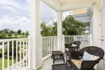 The balcony has upscale patio furniture and Reunion Resort views