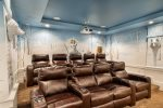 Get comfortable on leather theater-style recliners with cup holders