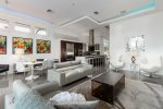 Ultra modern living space that perfectly blends pops of colors and neutrals