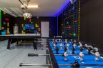 Test your hand at Foosball, or if you`re better at ice hockey start hitting some pucks