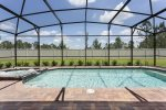 Relax in your own screened in pool with spillover spa