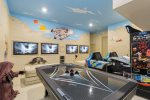 A second games room with an Xbox One, PlayStation 4, and 47-inch SMART TV x4