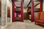 Send the kids to Hogwarts in this Harry Potter themed bedroom with custom bunk beds