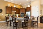 This beautiful kitchen offers stainless appliances and a large breakfast bar/island