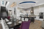 The dining and kitchen space flow beautifully together