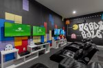 This game room is fully equipped with PS4 and Xbox One