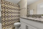 This family style bathroom is located near the theater room and bedroom 5.
