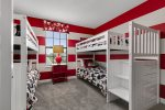 This Mickey Mouse themed kids room has two twin over twin bunkbeds