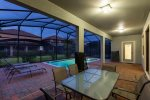 Enjoy the pool at twilight hours under the lanai
