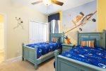 A twin/twin themed bedroom the kids will love