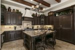 The kitchen features custom appliances and cupboards