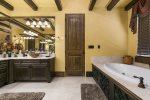 The master bathroom is spacious and offers you the utmost in luxury