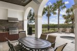 Dine out by the pool using the summer kitchen and ample seating