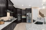 The upgraded kitchen has stainless steel appliances, granite counters and everything you need to prepare something great