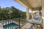 Unwind on your private balcony overlooking the pool