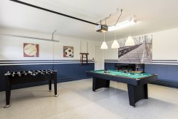 Challenge each other to a game of pool or Foosball in the game room