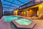 Enjoy the private pool with spillover spa in the mild Florida twilight