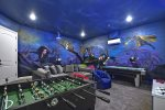 Play all day long with the foosball table, air hockey table and video game system