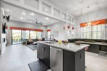 The kitchen offers a view of the living and dining area