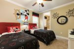 The Mickey Mouse theme bedroom features 2 twin beds