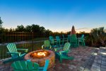 This home boasts a extended deck with firepit