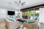 The living area opens out to your private west facing pool deck.