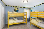 The Minions theme bedroom features two sets of twin/twin bunk beds.