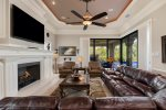 Comfortable seating around the TV and fireplace