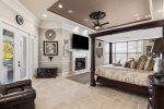 Unwind in your master suite with 80 inch SMART TV and easy access to the pool. Fireplace is Not Active