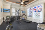 The private gym has an Olympic theme, 2 TVs, and multiple pieces of equipment.
