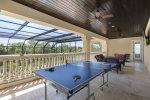 The second floor balcony has an 80 inch SMART TV and ping pong table.