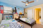 The kids will love their custom bedroom with two twin bed