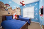Another fun kids bedroom features two twin beds
