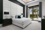 Master bedroom on the main floor with private access to the pool and luxurious furnishings