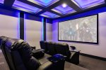 Private theater room with a 110 inch screen and comfortable seating