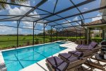 Enjoy the Florida sun in the pool or lounging nearby