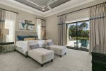 This master suite features king size bed, 65-inch SMART, en-suite bathroom, and access to pool area