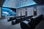 Enjoy your favorite movie with the 16-foot wide projection screen, 1080p projector, surround sound, and decorative tin ceiling