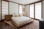 The Maui theme master suite features sliding Japanese shoji screens and a custome solid walnut bed
