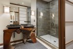 The en-suite bathroom has a dual vanity and glass walk-in shower