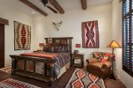 The Santa Fe theme bedroom features a king bed, en-suite bathroom, and 48-inch SMART 4K TV