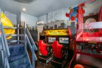 The game room features an air hockey table, 70-inch TV, and an awesome slide