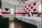 The Mickey Suite is a fun kids bedroom with two queen beds