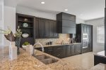 The modern and newly updated kitchen opens out into the living area
