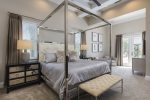 The master suite located on the first floor features a king size bed