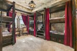 The Wizardy themed kid`s bedroom features custom built twin over twin bunk beds