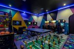 The ground floor games room features a foosball table, ping pong table, lots of arcade games, Xbox One & PS4