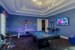 The games room features an air hockey table, pool table, 60-inch SMART TV, and more